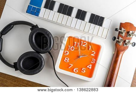 Music Entertainment Enjoy fun time. Music instrument practice time. Music production time. Music headphone with orange clock. Music listening time.