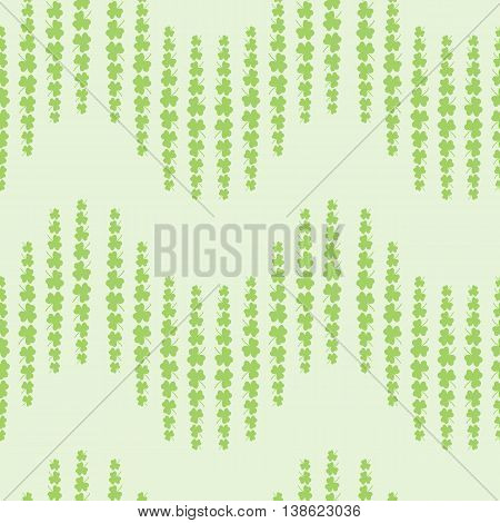 Nice pattern with clover leaves on green background
