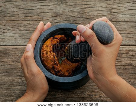 The Women Hold Pestle With Mortar And And Spice Red Curry Paste Ingredient Of Thai Popular Food On R
