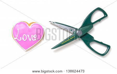 Breaking up. Scissors cutting heart isolated on white. Heart surgery.