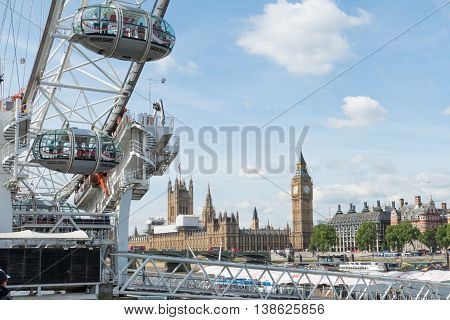 London, England - July 7, 2016:  London eye capsules with a view of Central London. The London Eye is a giant Ferris wheel on the South Bank of the River Thames, Also known as the Millennium Wheel