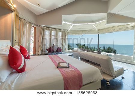 Modern style of living room with bed in resort Thailand