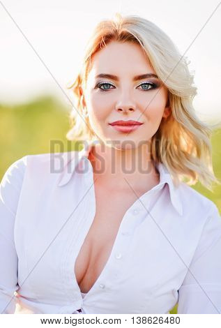Outdoor closeup portrait of smiling cute young woman