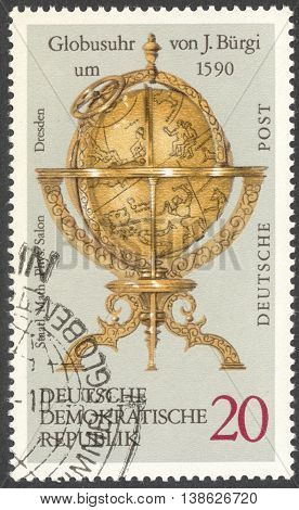MOSCOW RUSSIA - CIRCA FEBRUARY 2016: a post stamp printed in DDR shows Globe clock by J. Burgi the series