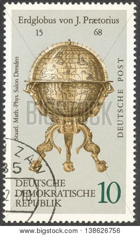 MOSCOW RUSSIA - CIRCA FEBRUARY 2016: a post stamp printed in DDR shows a vintage globe the series