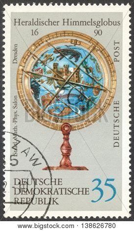MOSCOW RUSSIA - CIRCA FEBRUARY 2016: a post stamp printed in DDR shows heraldic sky-globe the series