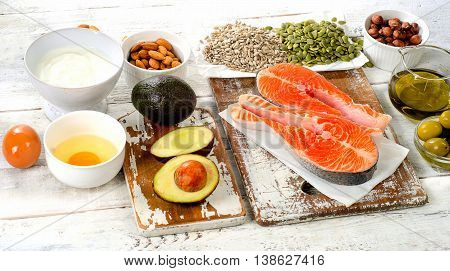 Best Sources Of Unsaturated Fats On White Wooden Background.
