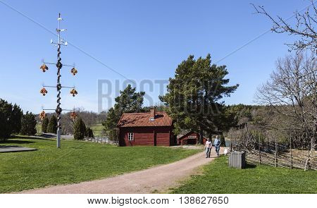 KASTELLHOLM, ALAND ON MAY 08. View of the Jan Karlsgården Open-air Museum on May 08, 2016 in Kastellholm, Aland. Homestead, buildings from 17th-18th. Unidentified people. Editorial use.