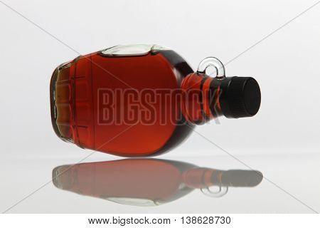 golden maple syrup on the white background