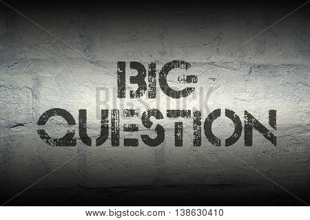 big question stencil print on the grunge white brick wall