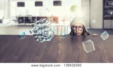 Hipster girl looking from under table . Mixed media