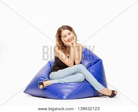 Asian Thai Girl Smiling And Hand Touch Face And Feel Relax On Bean Bag