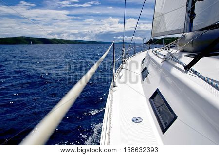 Side view of modern sailing boat on the sea.