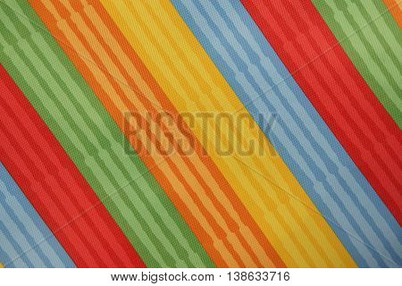 Abstract colorful background stripe textile texture. Macro photo.