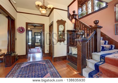 Hallway With Brown Trim And Hardwood Floor In Old House.