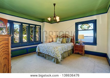 Adorable Antique Bedroom Interior With Green Ceiling And Blue Trim.