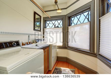Old Laundry Room Interior With White Appliances And Vintage Windows.