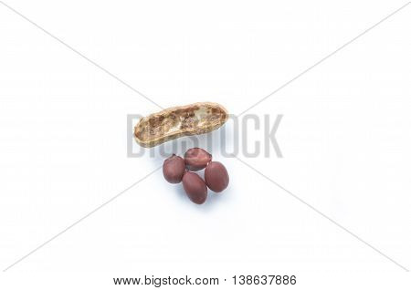 Cracked peanuts and peanuts in nutshell on white background