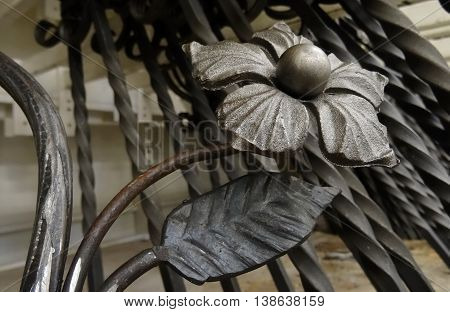 Wrought iron. Malleation flower decoration part of the iron fence