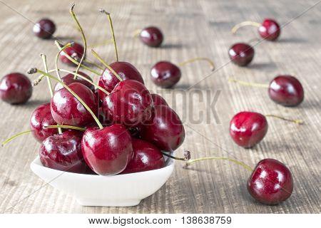 Cherries In White Bowl.