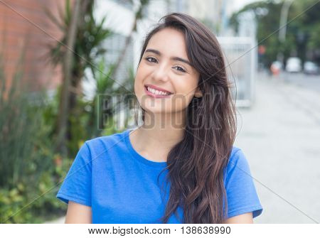 Happy caucasian woman with blue in city in the summer