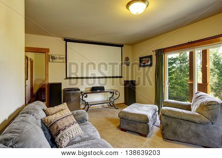 Cinema Room In American House With Projector Screen On The Wall