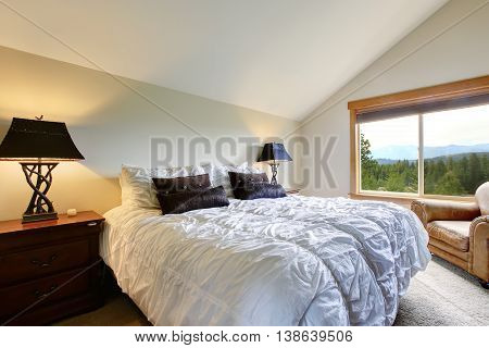 Nice Upstairs Bedroom With Vaulted Ceiling And Carpet Floor.