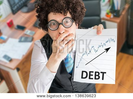 Shocked Accountant Is Showing Chart With Increasing Debts.