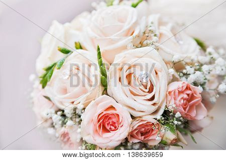 Wedding bouquet. Bride's traditional symbolic accessory. Floral composition with pink rose flowers.