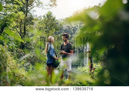 Couple Of Hikers Together In Forest