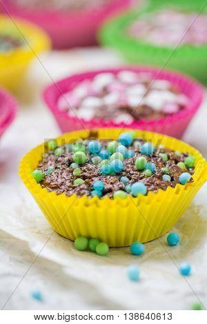 Colourful vertigo: muffins in different colors .