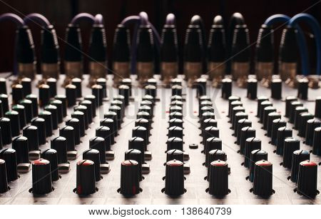 Knobs of a studio soundboard with cord jack