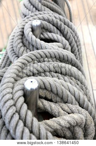 rope wound in a ring on a wooden deck