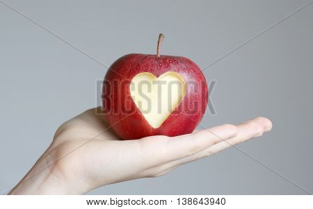 hand with apple, with a heart.