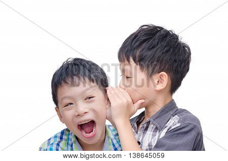 Young Asian brother whispering his twin on white background