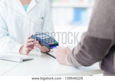Man Purchasing Products In The Pharmacy