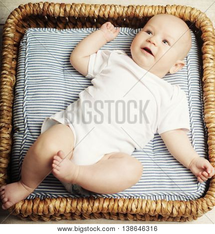 little cute baby boy  lying in basket