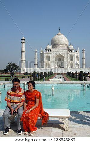 Agra, Utta Pradesh, India - march 07, 2006: Couple posing for a photo, in the gardens of the Taj Mahal