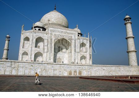 Agra, Utta Pradesh, India - march 07, 2006: Solitary man walking along the esplanade that extends under the building of the Taj Mahal