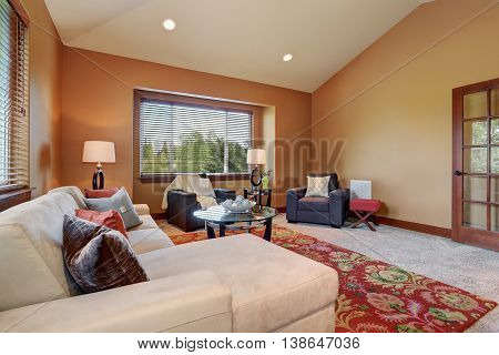 Cozy Living Room With High Vaulted Ceiling And Mocha Walls.