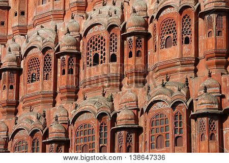 Detail of windows of the exterior facade of the Hawa Mahal or Palace of the Winds , Jaipur , India