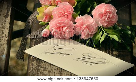 Pink Floral bouquet background and get well tag/card