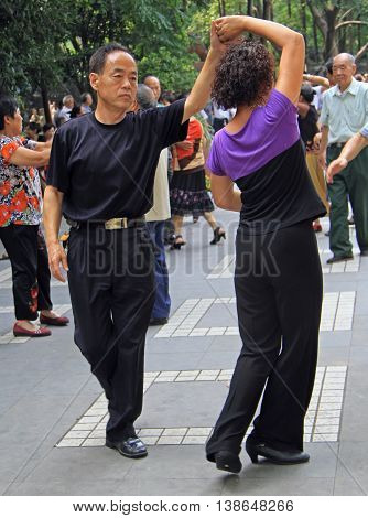 People Are Dancing In Park Of Chengdu