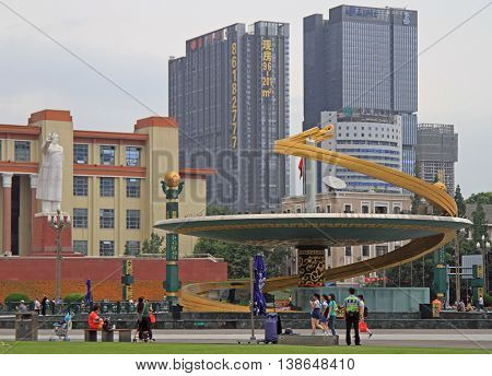 Chengdu China - June 14 2015: people are walking by square in front of Sichuan Science and Technology Museum in Chengdu China