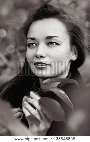 Portrait of beautiful woman outdoors