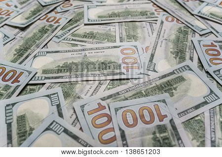 One hundred dollars background. Background paved with hundred dollar bills.
