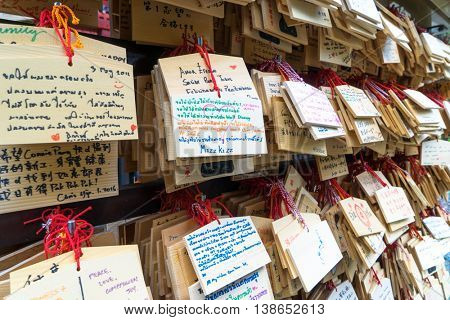 tokyo,japan: wood plates with good wish hanging in temple in tokyo by zhudifeng on May,25,2016