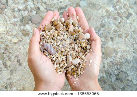 hand stones pebble beach sea smooth natural erosion