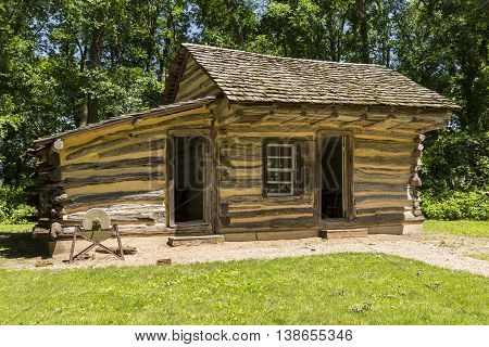 An old historic log cabin in the woods.