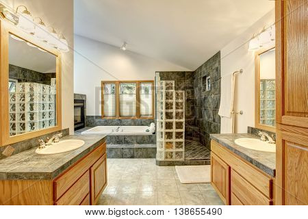 Master Bathroom Interior With Tile Flooring And Modern Cabinets.